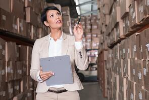 Warehouse manager checking her inventory in a large warehouse-1.jpeg