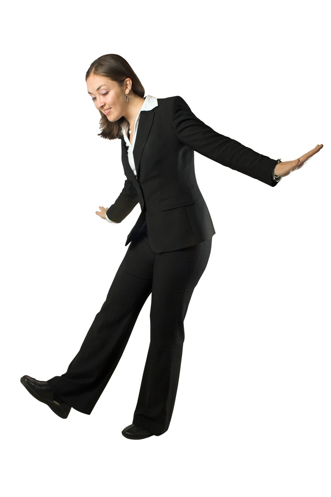 business woman trying to avoid falling.jpeg